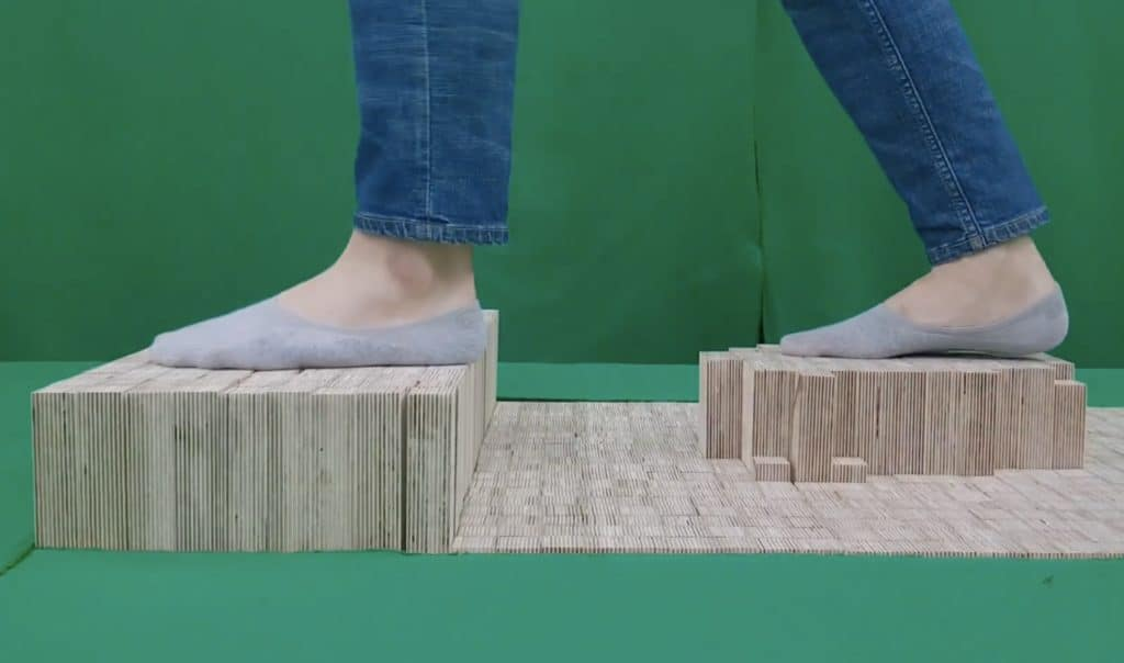 Elevate is a walkable pin array floor that generates shape-changing terrain for VR